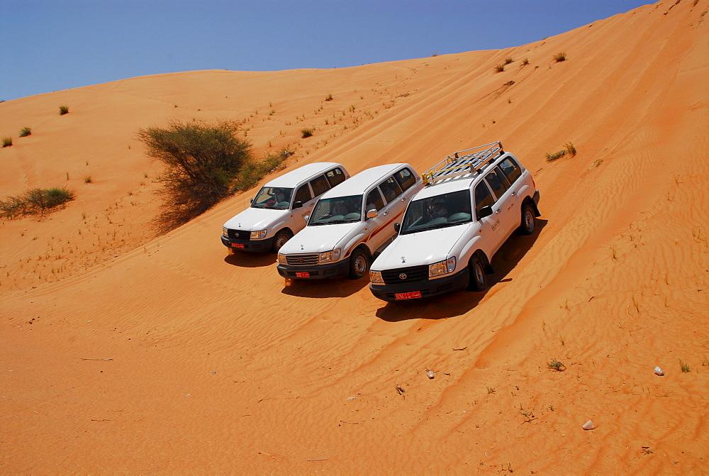 Cars on dune, Wahiba desert, Oman