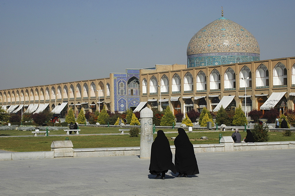 Two veiled women in front of Sheikh Lotf Allah Mosque at Meidan-e Imam (Imam Square), Isfahan, Iran