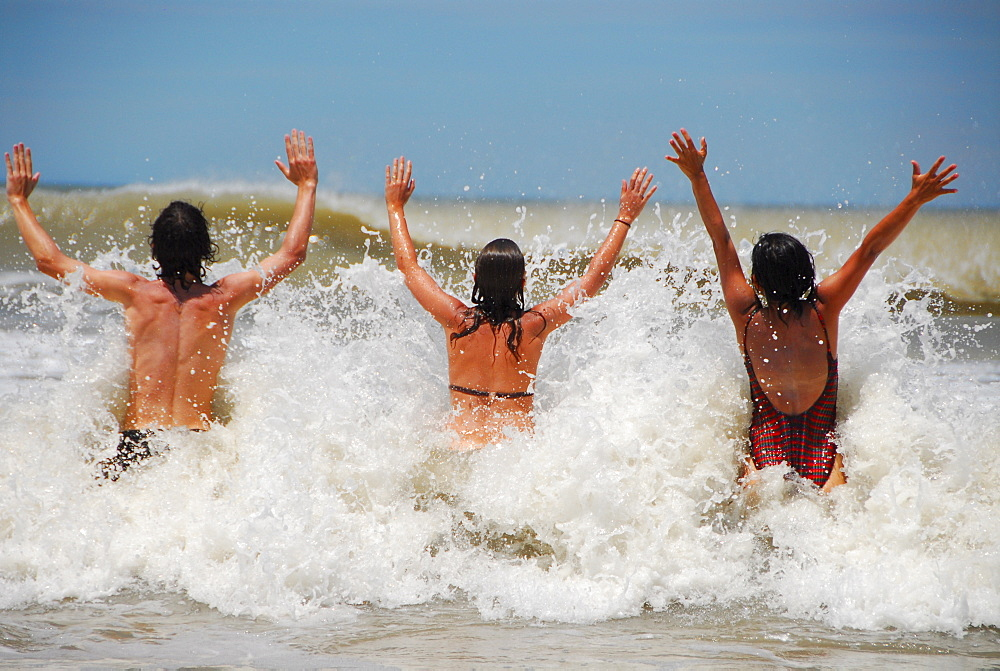Young people having a bath at Pinamar beach, Buenos Aires province, Argentina