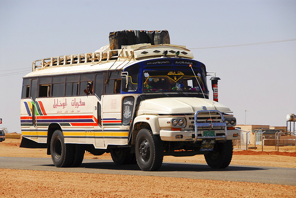 Bus on country road near Naga, Sudan, Africa
