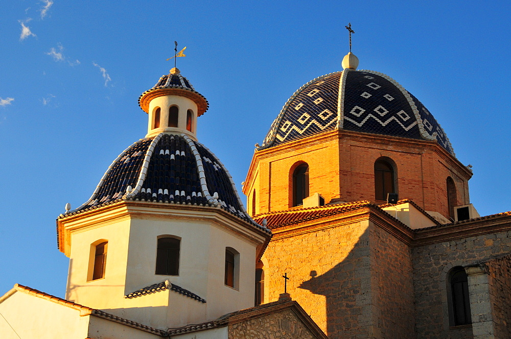 Tiled domes of the golden yellow Iglesia de Nuestra Senora del Consuelo Church, Altea, Costa Blanca, Spain