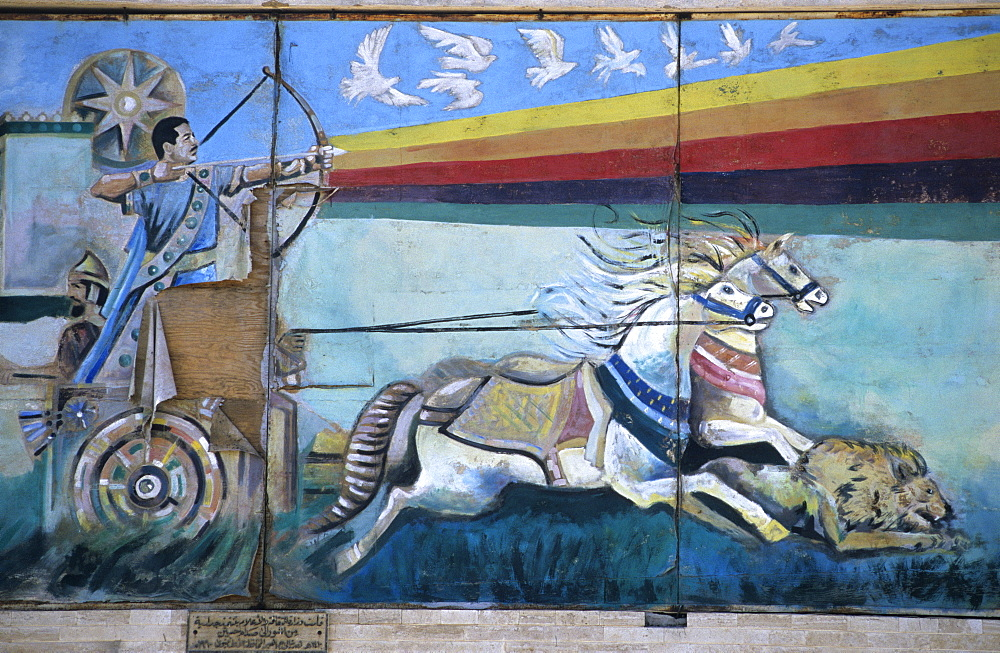 Wall mural depicting Saddam Hussein shooting an arrow from a bow while riding down a lion from a Roman war chariot, painting since destroyed, Mosul, Iraq, Middle East