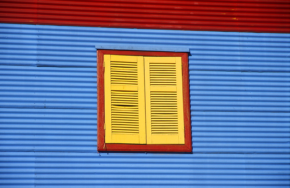 Multicoloured house front in the tourist alleys of Caminito in the docklands of La Boca, Buenos Aires, Argentina, South America