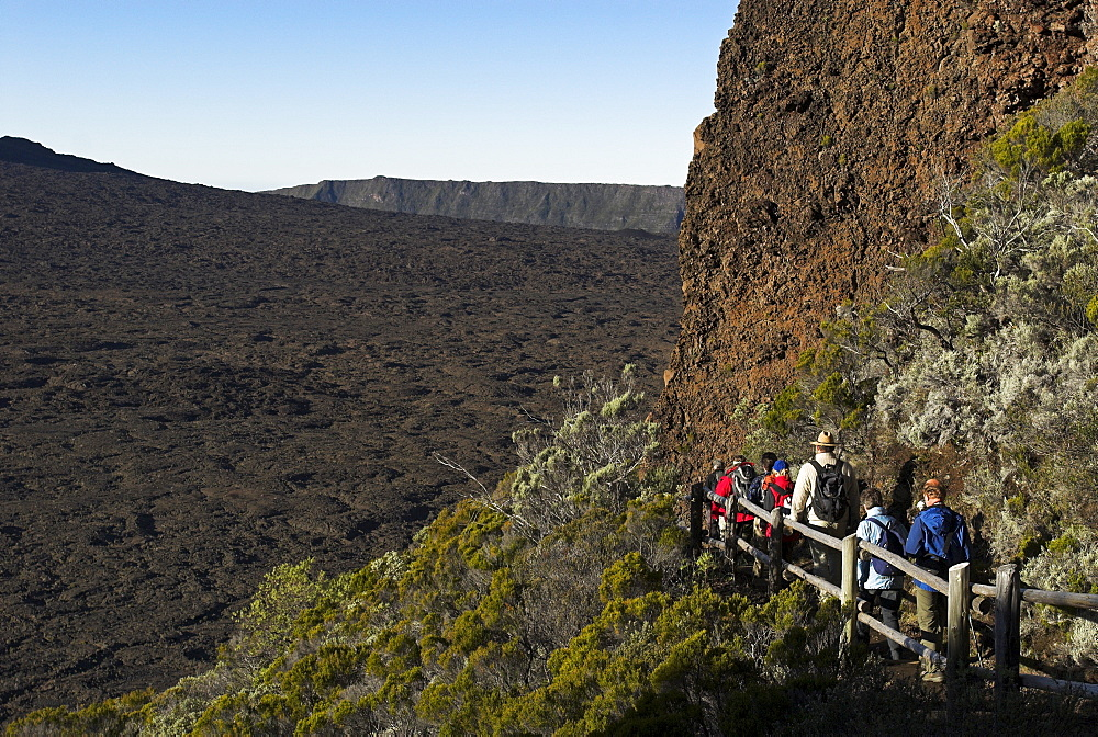 Hiker in the caldera of Piton de la Fournaise volcano, La Reunion Island, France, Africa