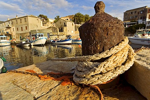 Rusty belayer in the harbour of Centuri, Corsica, France