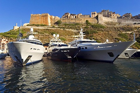 Megayachts anchoring below the old town of Bonifacio, Corsica, France