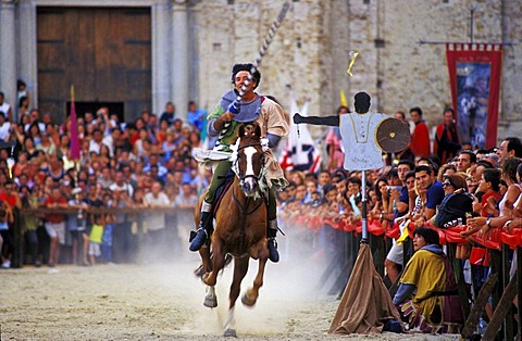 Palio, medieval joust in Stilo, rider tries to spike a little ring, Calabria, Italy