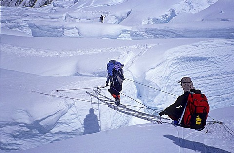 Crossing of a crevasse by ladder, Western Cwm, 6000m Mount Everest, Himalaya, Nepal
