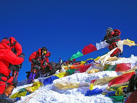 Mountain guide Vern Tejas and Lhakpa Rita Sherpa with tibetan praying flags on the summit of Mount Everest 8848m, Himalaya, Nepal