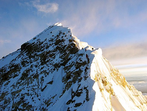 Climbers on the Summit Ridge to the summit of mount Everest, 8848m, as seen from South Summit, 8751m, Himalaya, Nepal