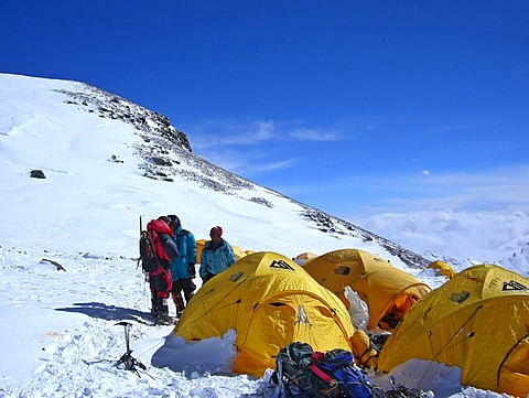 Yellow tents, alpinists and equipment in Camp IV, 4, on South Col, 7950m, Mount Everest, Himalaya, Nepal