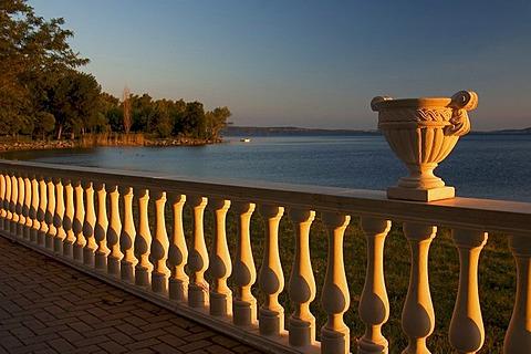 Vase on balustrade at sunset, Lago di Bolsena, Latium, Italy
