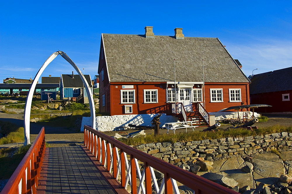Footbridge leading under an arch made of a whale's jaw bone, Local History Museum, Qeqertarsuaq, Disko Island, Disko Bay, Greenland, Arctic