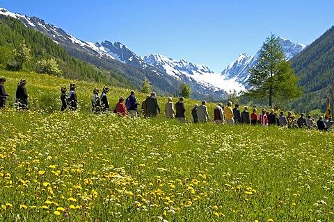 Tour around the village Corpus Christi procession Wiler Valais Switzerland