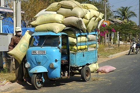 Heavily loaded mini-truck Vietnam