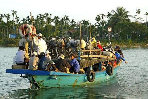 Overcrowded ferry boat crossing the Thu Bon River in Hoi An, Vietnam