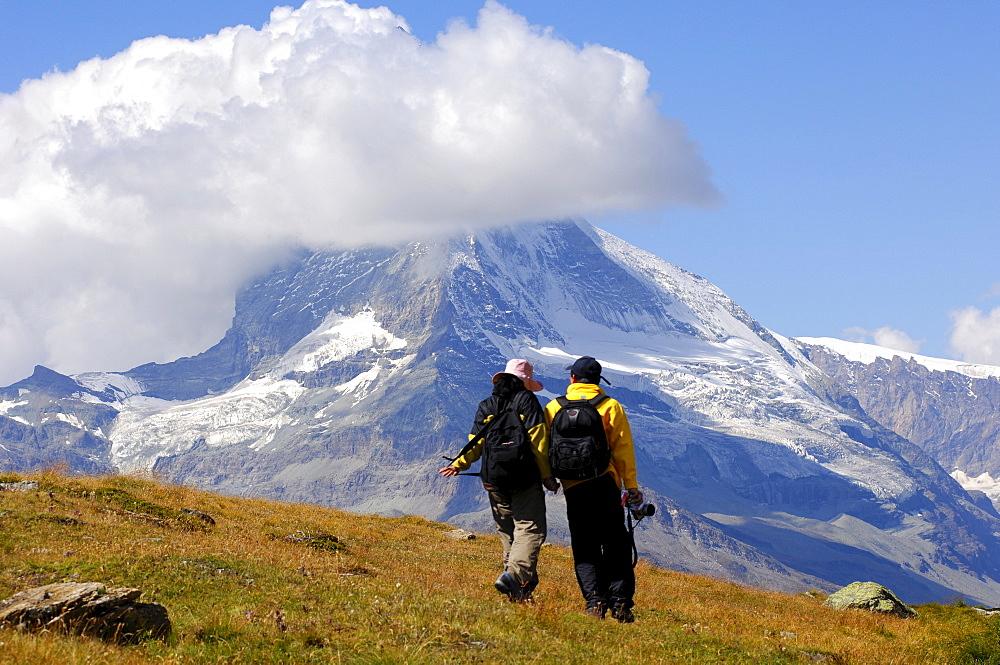 Tourists at the foot of Mount Cervin, Matterhorn, Zermatt, Switzerland