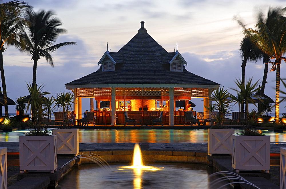 Twilight at the pool bar, Hotel Le Telfair, Mauritius