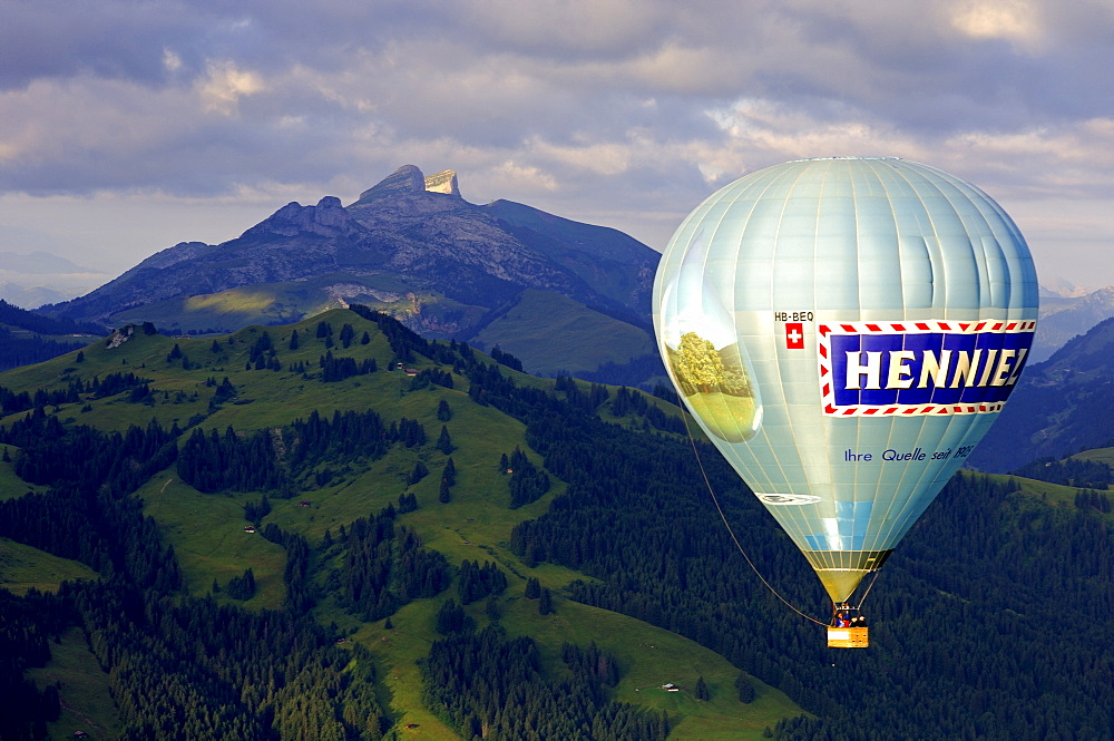 Hot air balloon in front of peaks Tour d'Ai, Tour de Mayen, Chateau-d'Oex, Switzerland