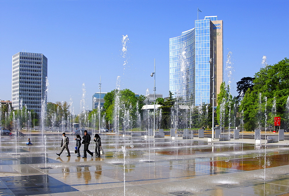 Trick fountains on the Square of Nations, Place des Nationen in Geneva, ITU Headquarters (left), WIPO, UPOV buildings on the right, Geneva, Switzerland