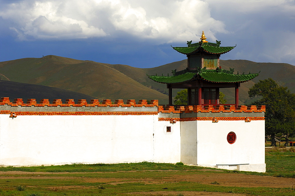 White wall and tower of the Mongolia Hotel built in the style of a Buddhist temple, steppes visible at back, Ulan Bator or Ulaanbaatar, Mongolia, Asia