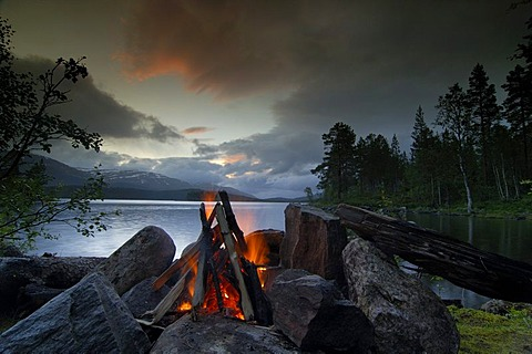 Campfire by lake