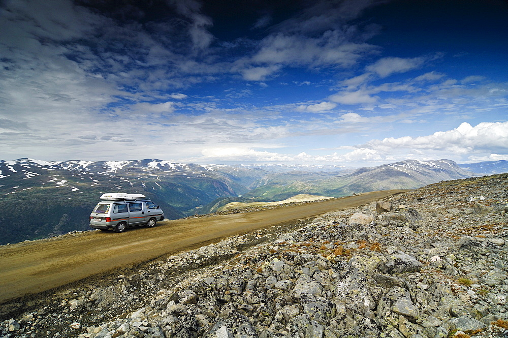 Camper on the road to the Galthoppingen, Jotunheimen National Park, Norway