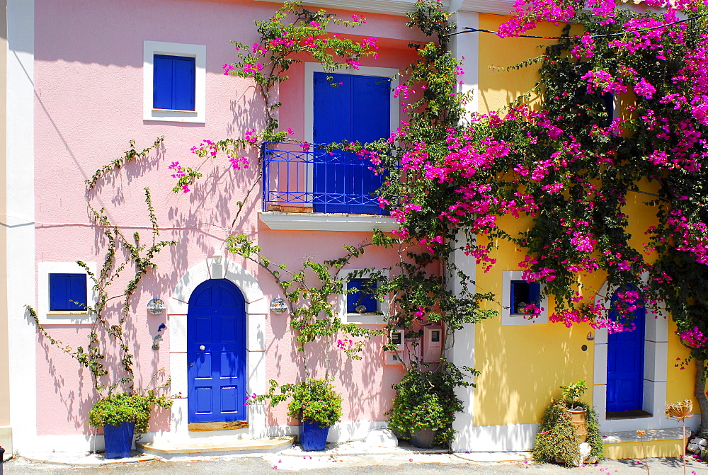 Pink and yellow house, blue shutters, Fiscardo, Kefalonia, Ionian Islands, Greece - 832-302704