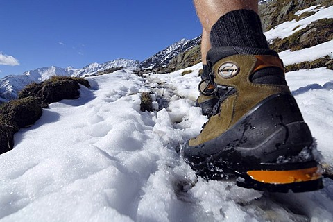 Feet and climbing boots of a hiker, Texelgruppe, South Tyrol, Italy