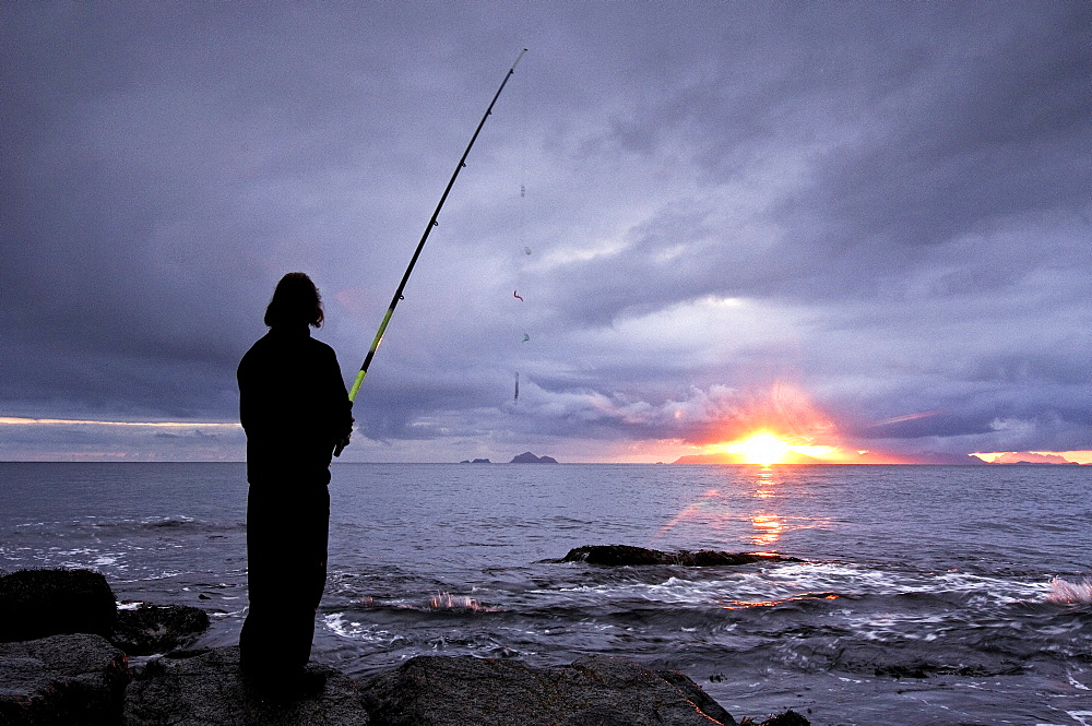 Fisherman on the beach, Lofoten Archipelago, Norway, Scandinavia, Europe