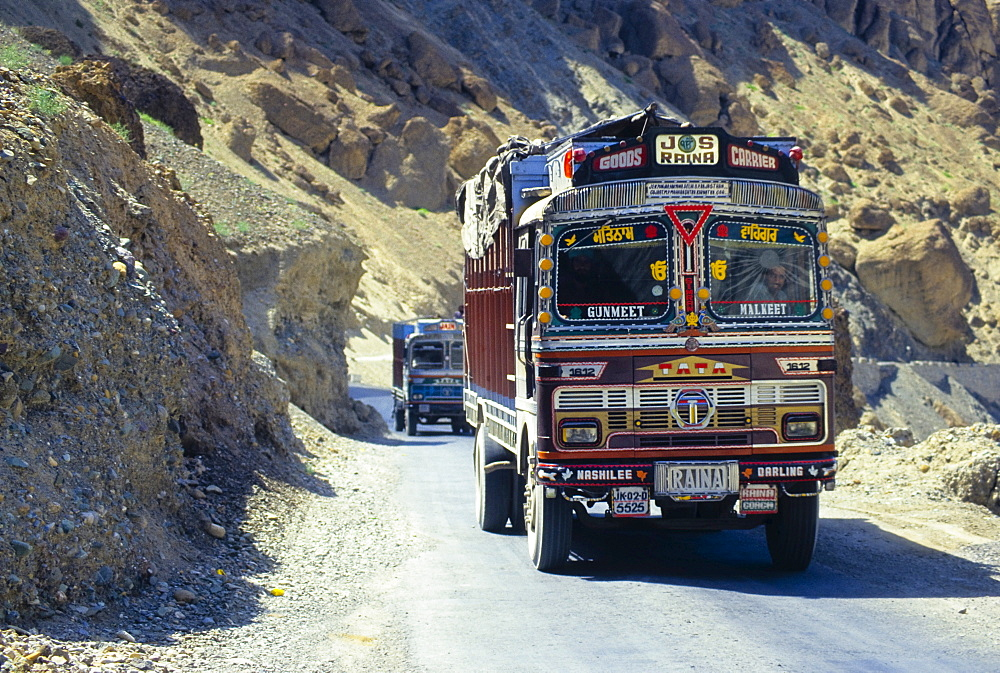 Colourfully painted truck driving along the main highway between Kashmir and Ladakh, India - 832-303045