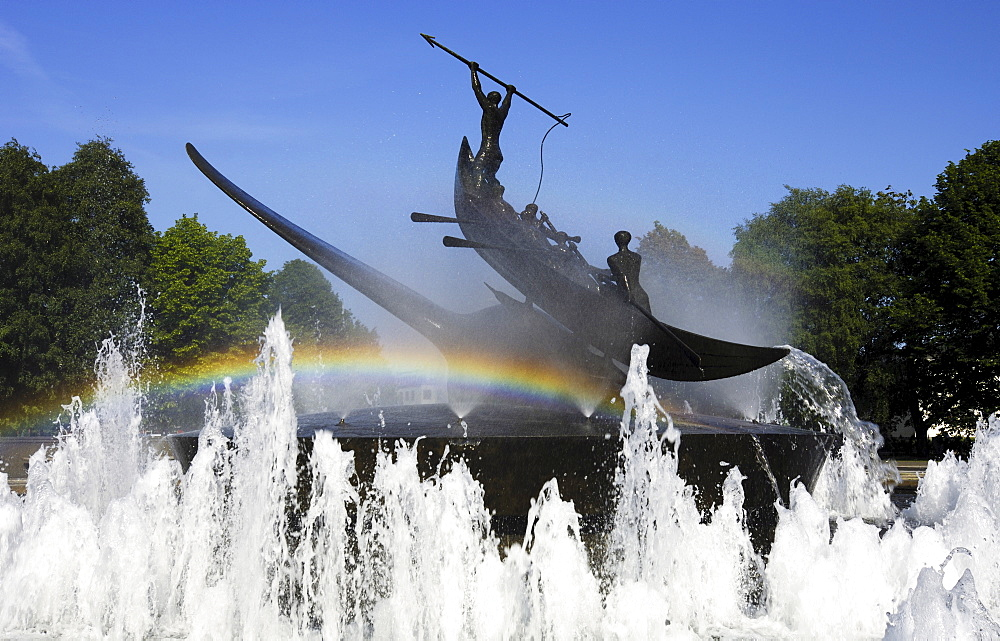 Rainbow over controversial whaling monument surrounded by a fountain created by Norwegian sculptor Knut Steen, Sandefjord, Vestfold, Norway, Scandinavia