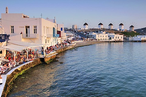 Tourists seated at restaurants in Little Venice, windmills, Mykonos Island, Cyclades, Greece, Europe