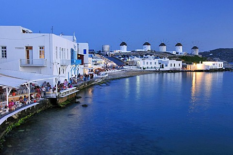 Tourists seated at restaurants in Little Venice, windmills, evening mood, Mykonos Island, Cyclades, Greece, Europe - 832-303321