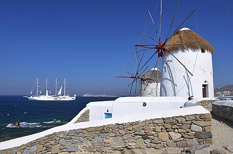 Windmills and white sailboat, bark, four-masted sailing ship, landmark of Mykonos Island, Cyclades, Greece, Europe - 832-303323