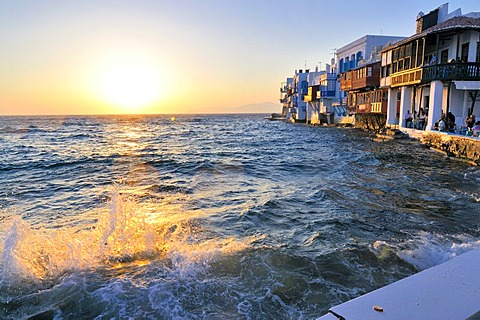 Surf with splashing waves at sunset at the beach near Little Venice, Mykonos, Cyclades, Greece, Europe