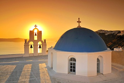 White Greek church with a blue dome and a bell tower at sunset, Firostefani, Santorini, Cyclades, Greece, Europe - 832-303407