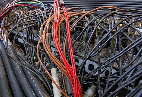 Jumble of cables behind a mixer in a sound studio