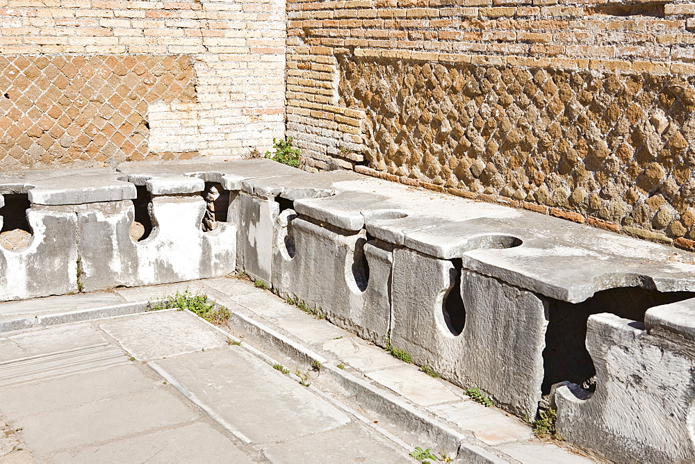 Ancient public toilets at Ostia Antica archaeological site, Rome, Italy, Europe