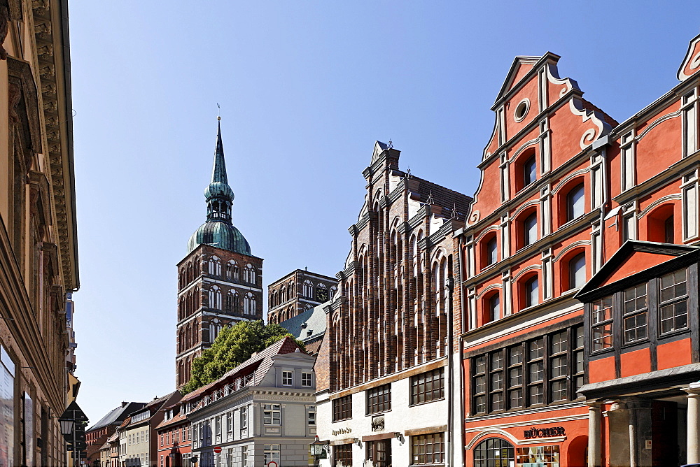 View of pharmacy and St. Nicholas Church in background, Badenstrasse, Stralsund, Mecklenburg-Western Pomerania, Germany, Europe