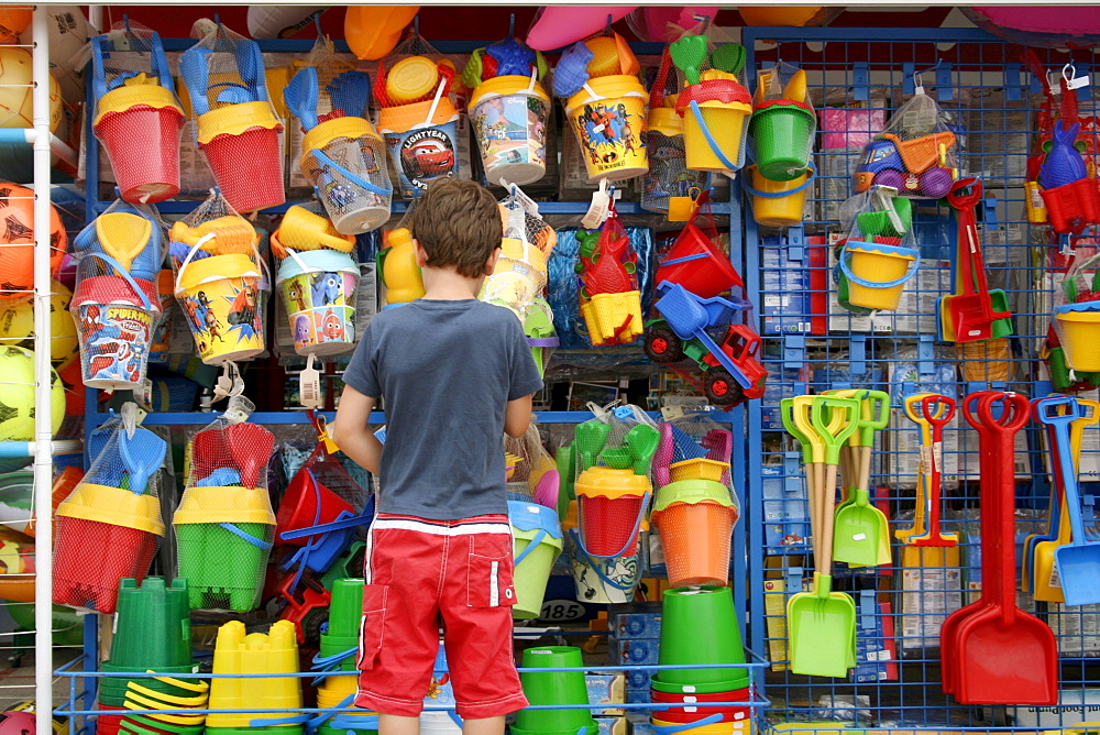 Child at a toy stand, Mallorca, Spain