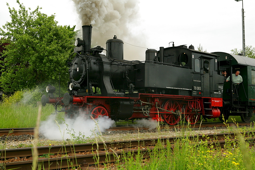 Historical steam train pulling a carriage