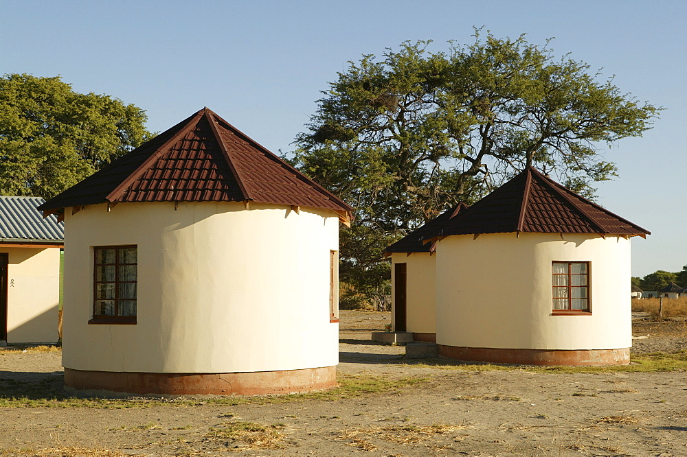 New buildings modeled after traditional round-huts, Sehitwa, Botswana, Africa