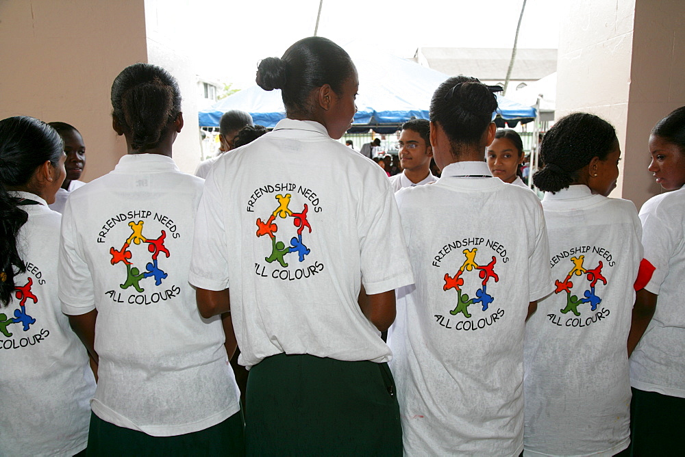T-shirts showing symbol for cooperation between people of various ethnic backgrounds during a protest against violence against women in Georgetown, Guyana, South America