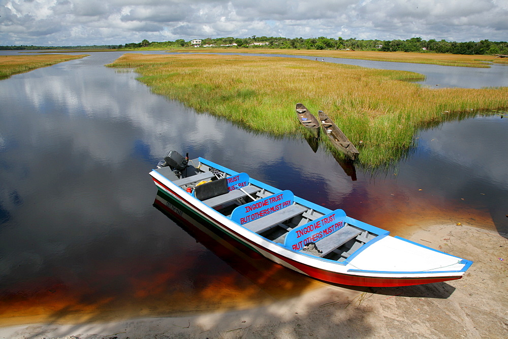 Wooden canoes at the shore of Lake Capoey, Guyana, South America