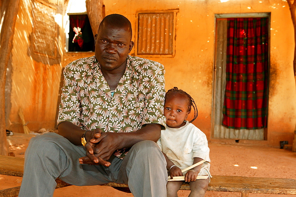 Father and half-orphaned child, HIV/AIDS infected, Cameroon, Africa