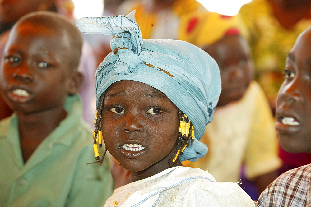 Girl wearing head-wrap, Cameroon, Africa