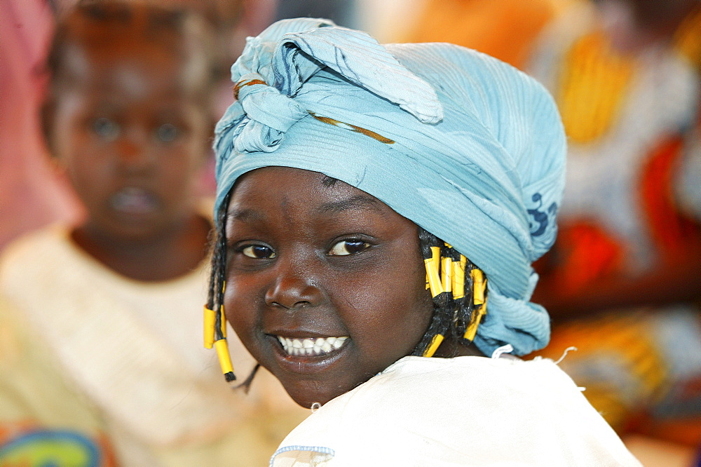Girl wearing a head-wrap, Cameroon, Africa