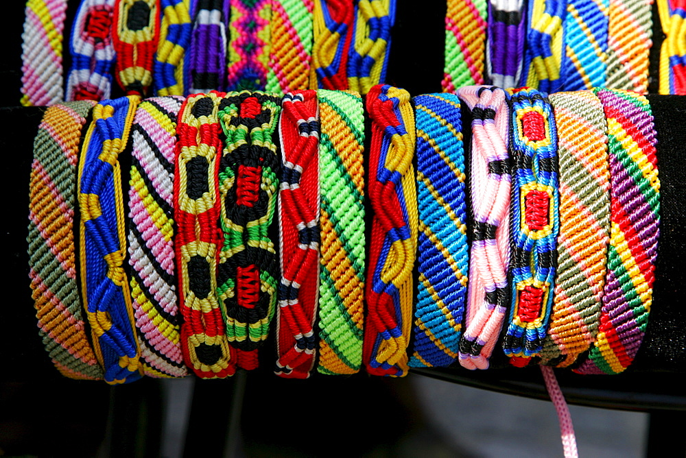 Colourful woven friendship bracelets sold at a market stand, Simonis Market, Muehldorf am Inn, Bavaria, Germany