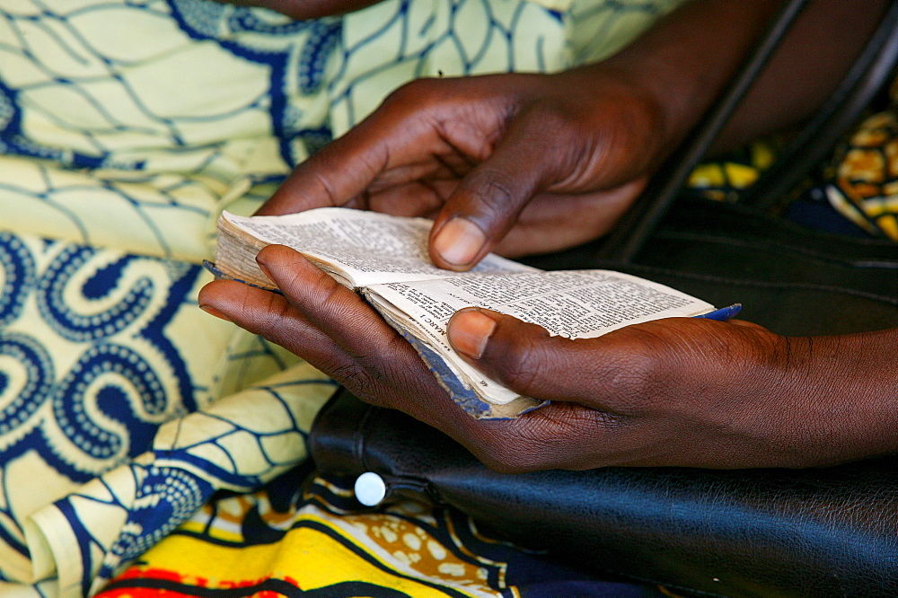 Hands holding a hymn book at a church service, Garoua, Cameroon, Africa
